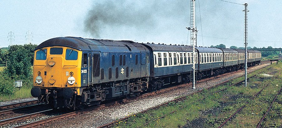 During Class 24s' 'Indian Summer' on the DMU replacement turn a year later in 1978, No. 24023 spits out a black exhaust as it clatters away from Shotton Low Level with 13.30 Manchester Victoria–Llandudno on July 11th. This machine was one of only six of the type still active at the time and was only to last another two months in traffic. Picture: David Rapson